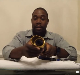 Video screenshot of a man reviewing exhaust pipe